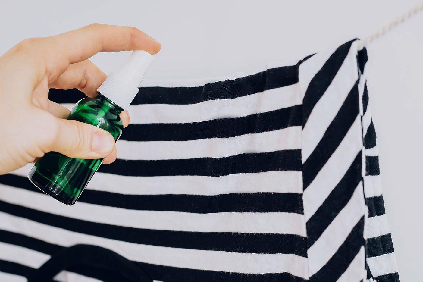 spraying a garment with deodorizer