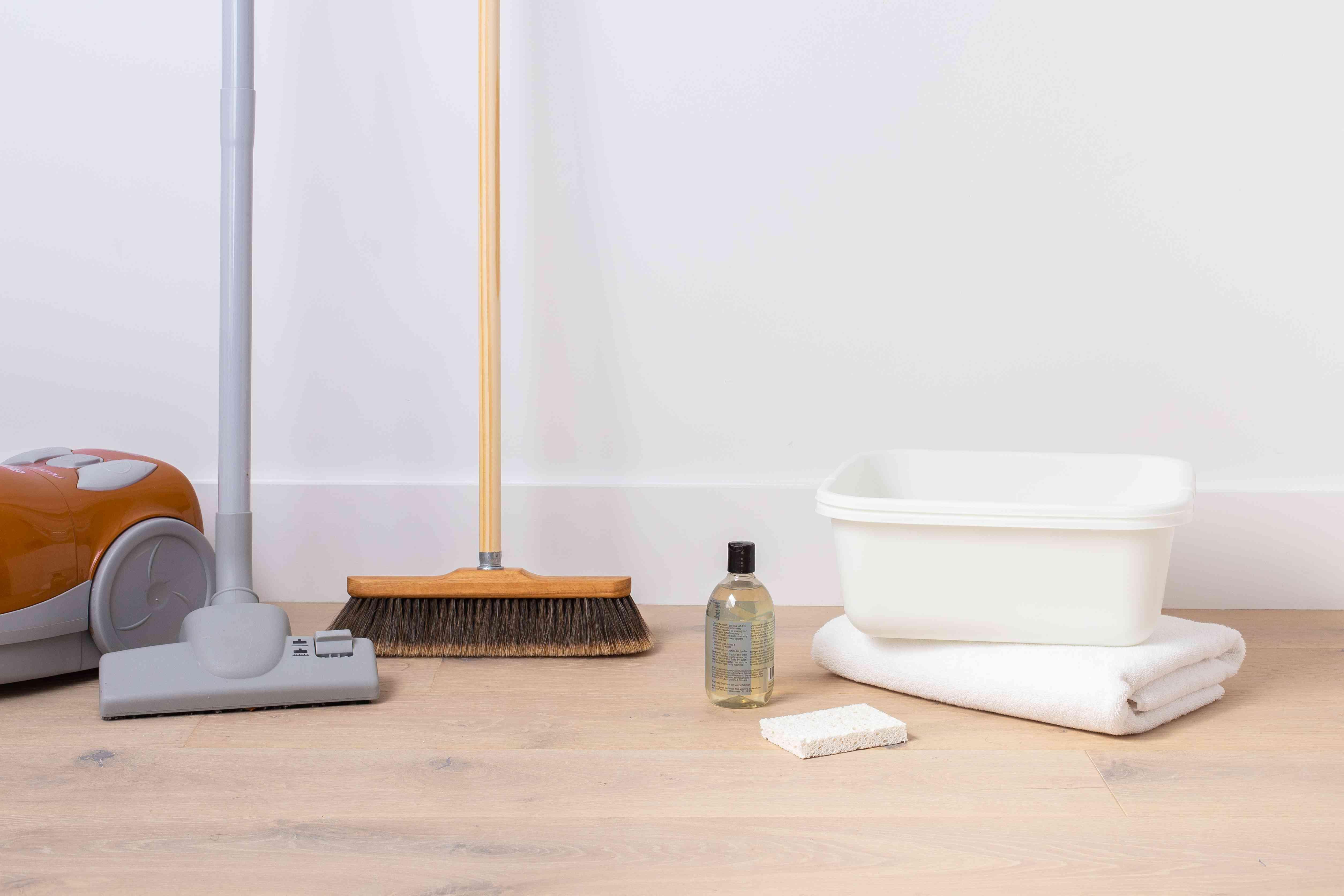 Broom, vacuum, bucket, folded towels, sponge and wool wash detergent materials cleaning wool rug