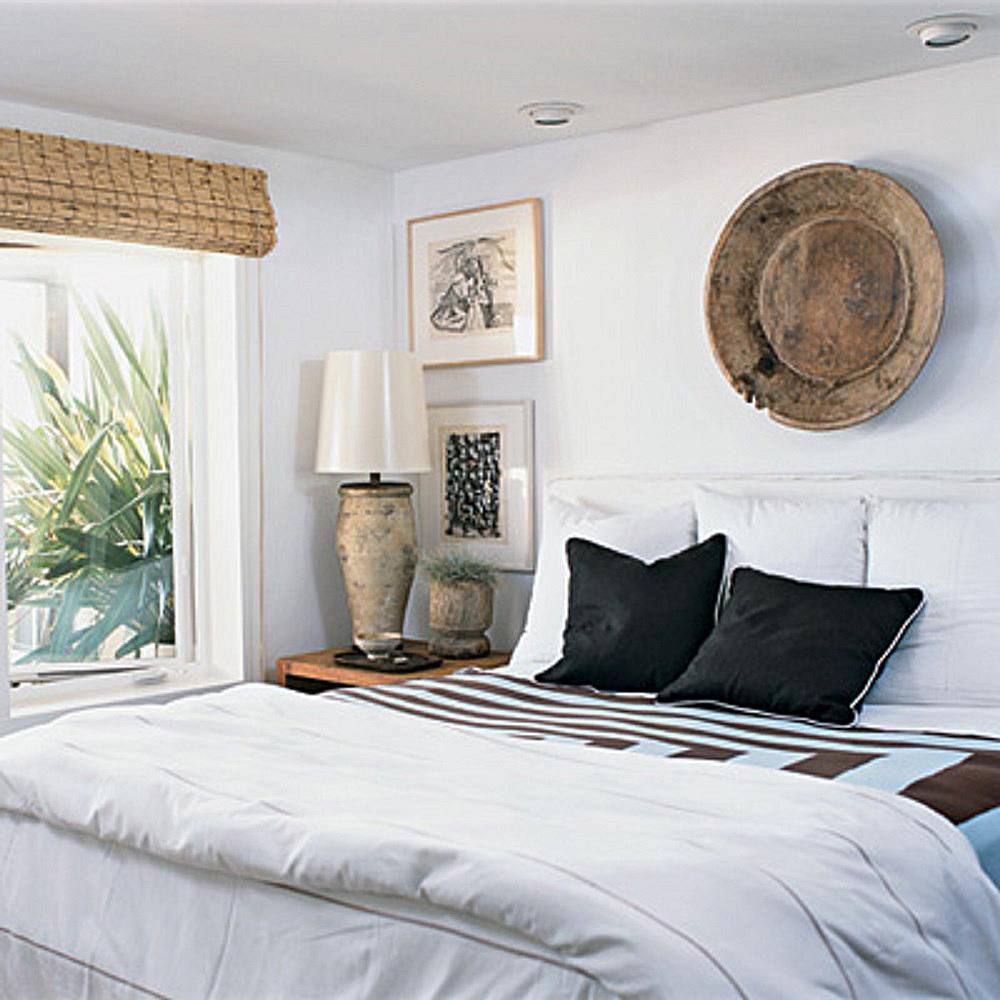 Bedroom with white walls and wood-colored accents