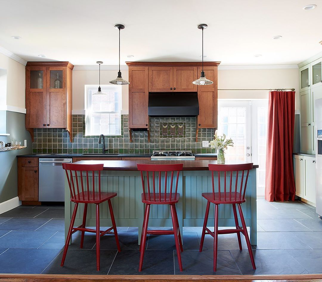 Kitchen with muted green cabinets