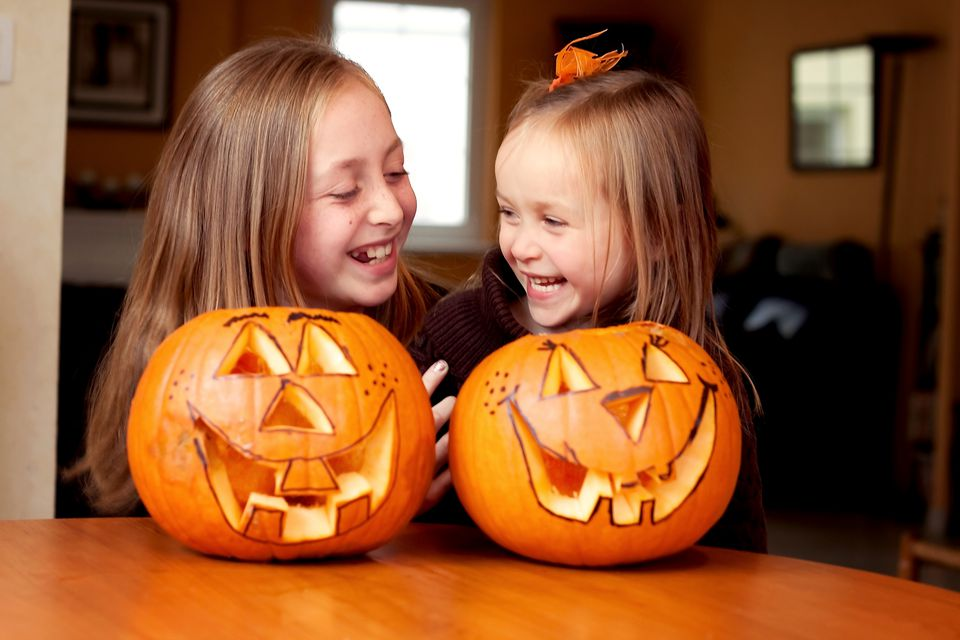 Sisters laughing and smiling on Halloween