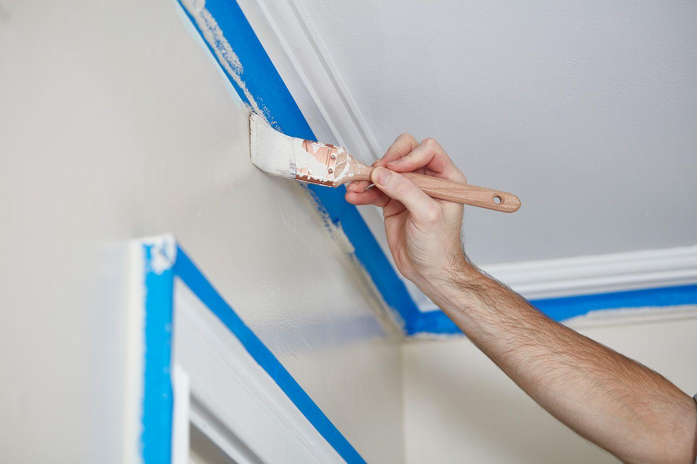 Man painting wall edges