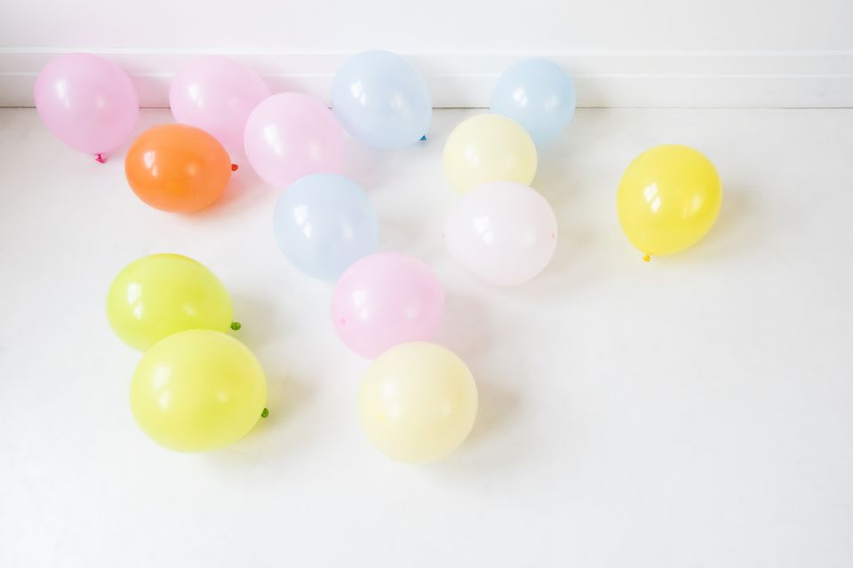 balloons on the floor for a balloon stomp game