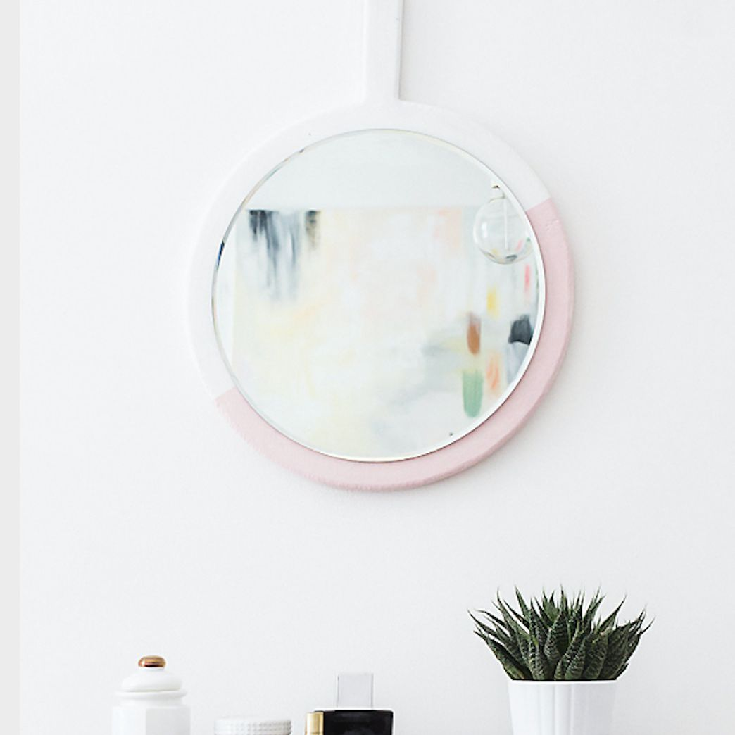 a round color block DIY mirror frame in pink and white