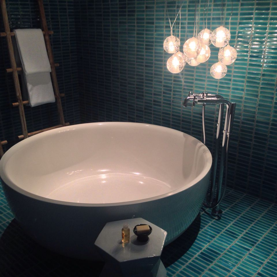 dramatic aqua tile in the bathroom