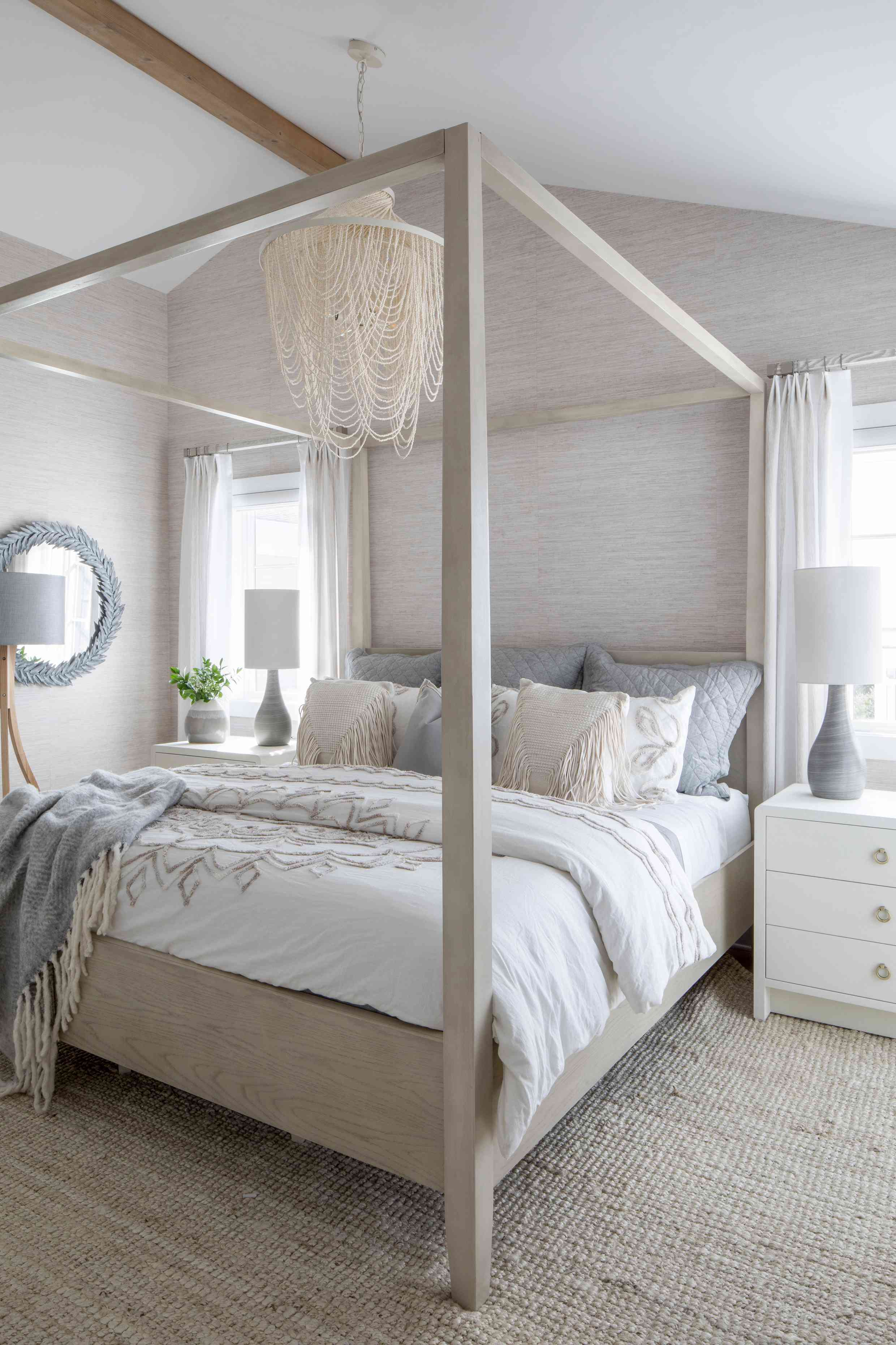 A bedroom in Karen B. Wolfe's Long Beach Island home, with sand, blue, and white colors