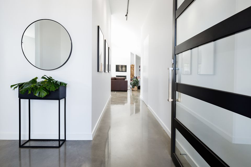 Contemporary home entry hall with polished floors