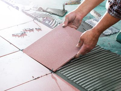Installing Tiles - Professional Worker