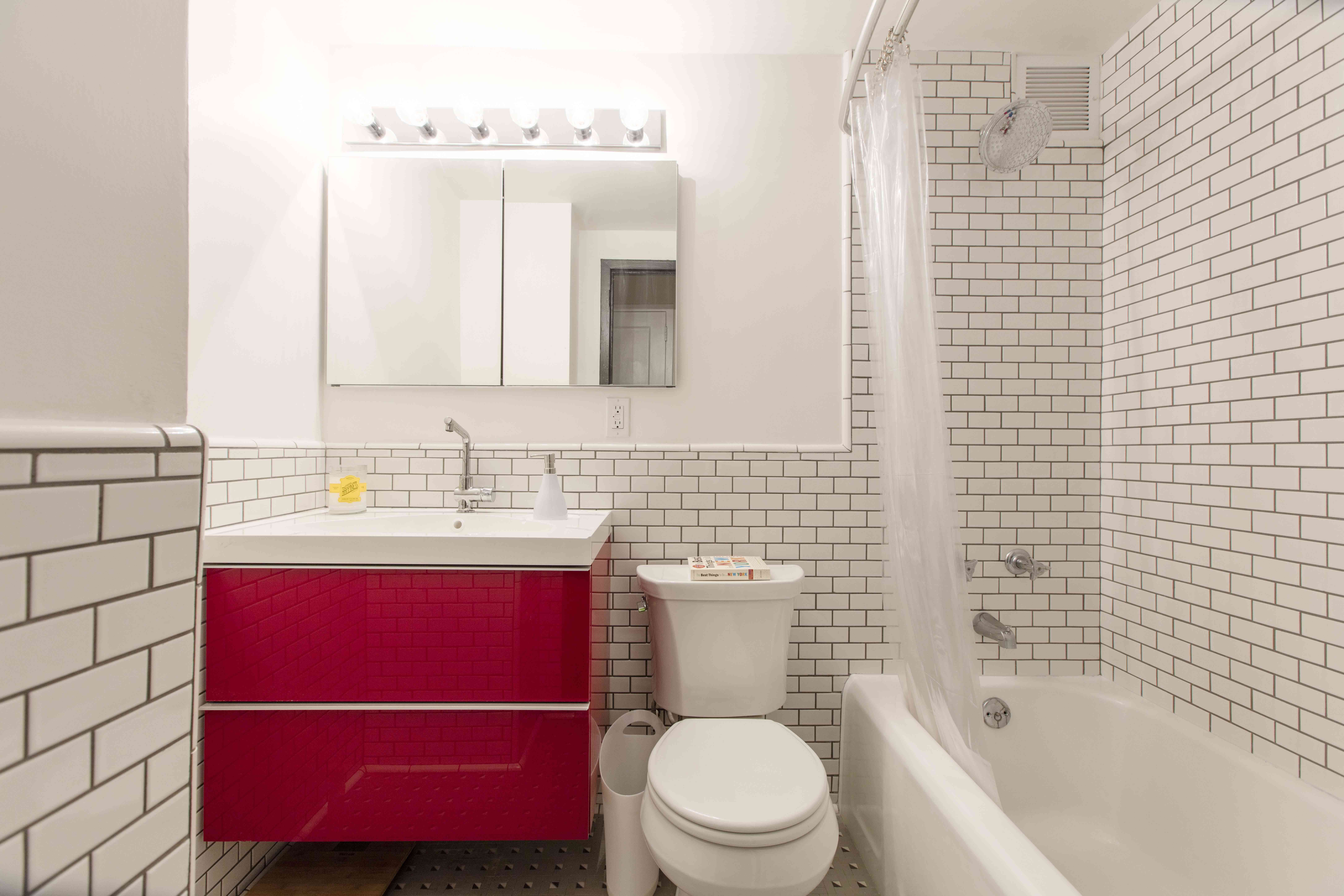 Pop-of-red-white-subway-time-bathroom