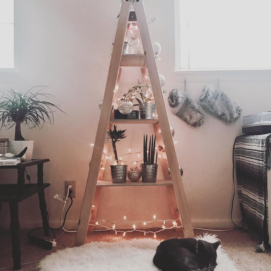 Wooden ladder decorated with string lights