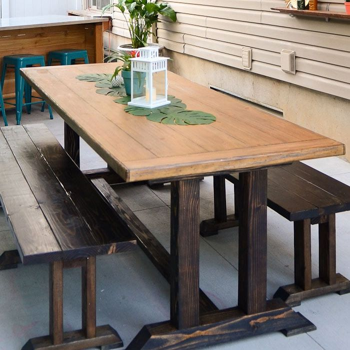 A dining room table and benches on a deck