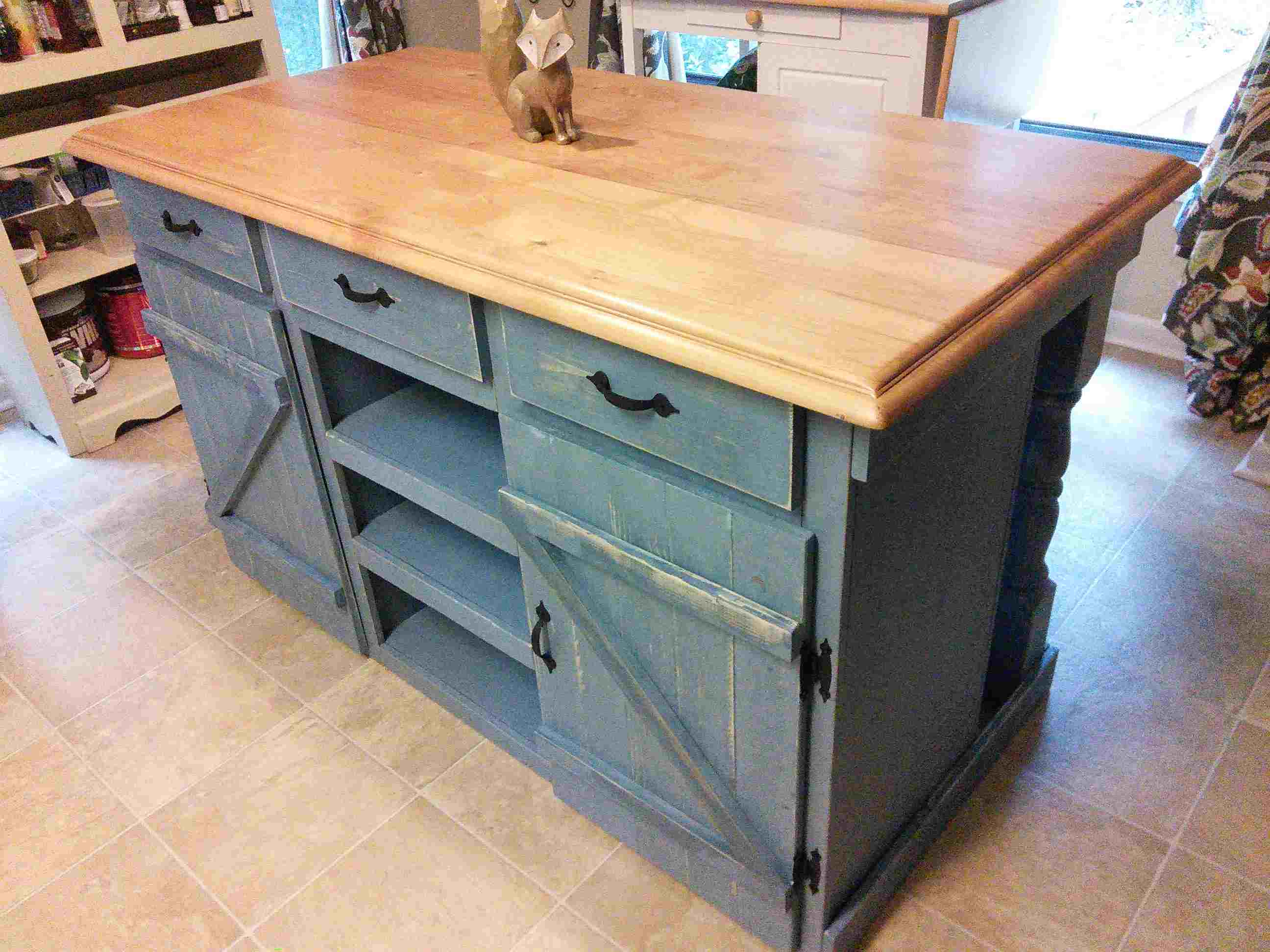 A Distressed Farmhouse Style Kitchen Island