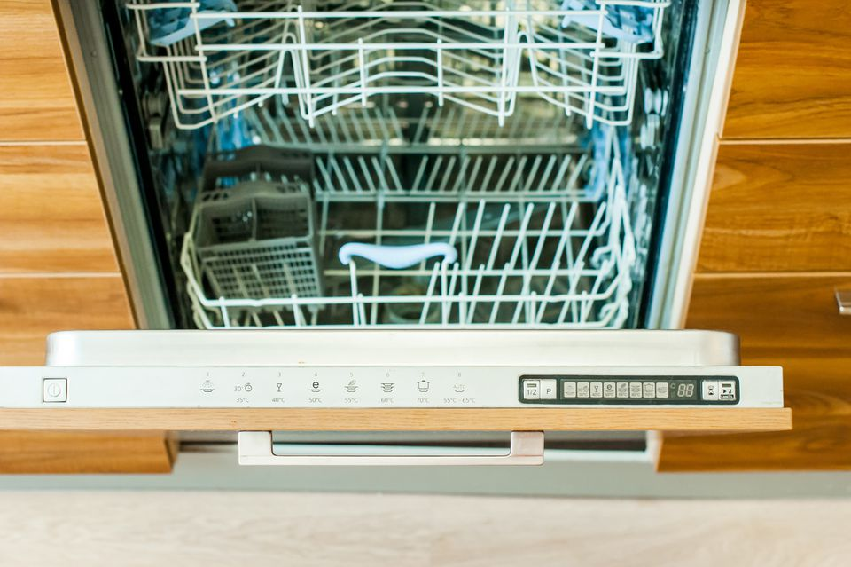 High-angle view of open dishwasher