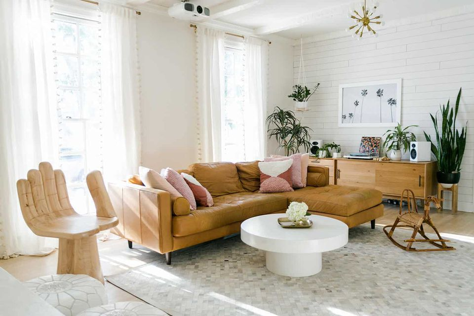 a living room with a leather sofa