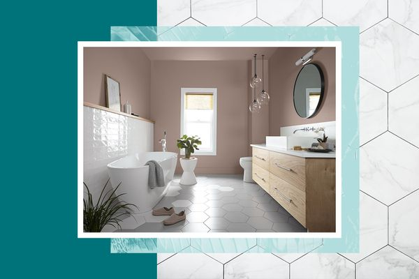 organic modernism bathroom features hexagon tiles, neutral paint, wood cabinetry, and lots of natural light