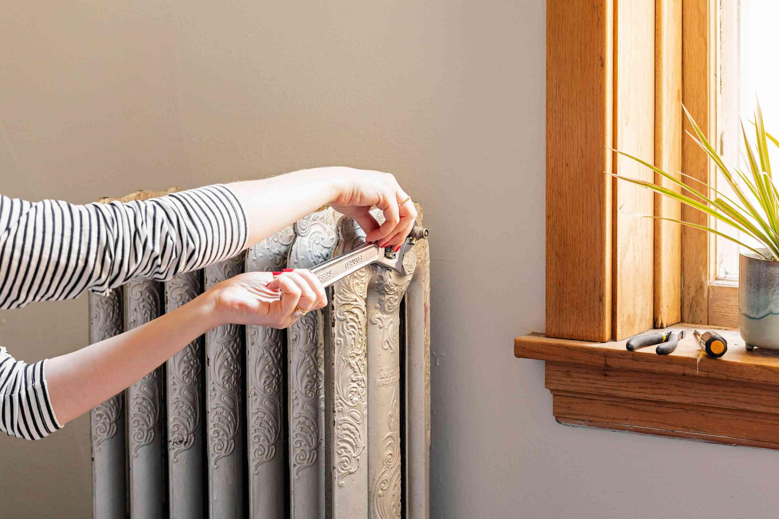 person performing radiator maintenance