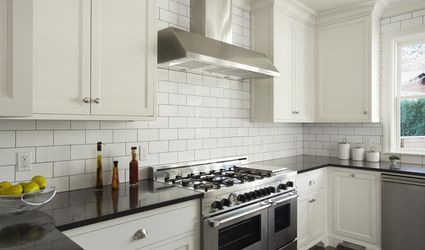Custom designed kitchen with white and professional stove