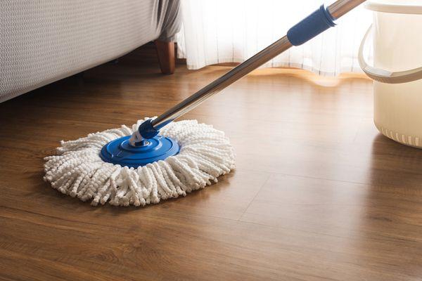 a microfiber mop on a wood floor