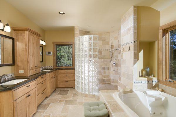Modern bathroom with large, open shower, jet tub
