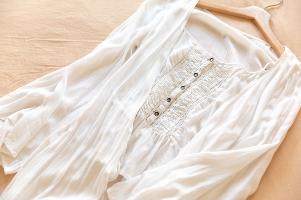 A white blouse on a brown hanger