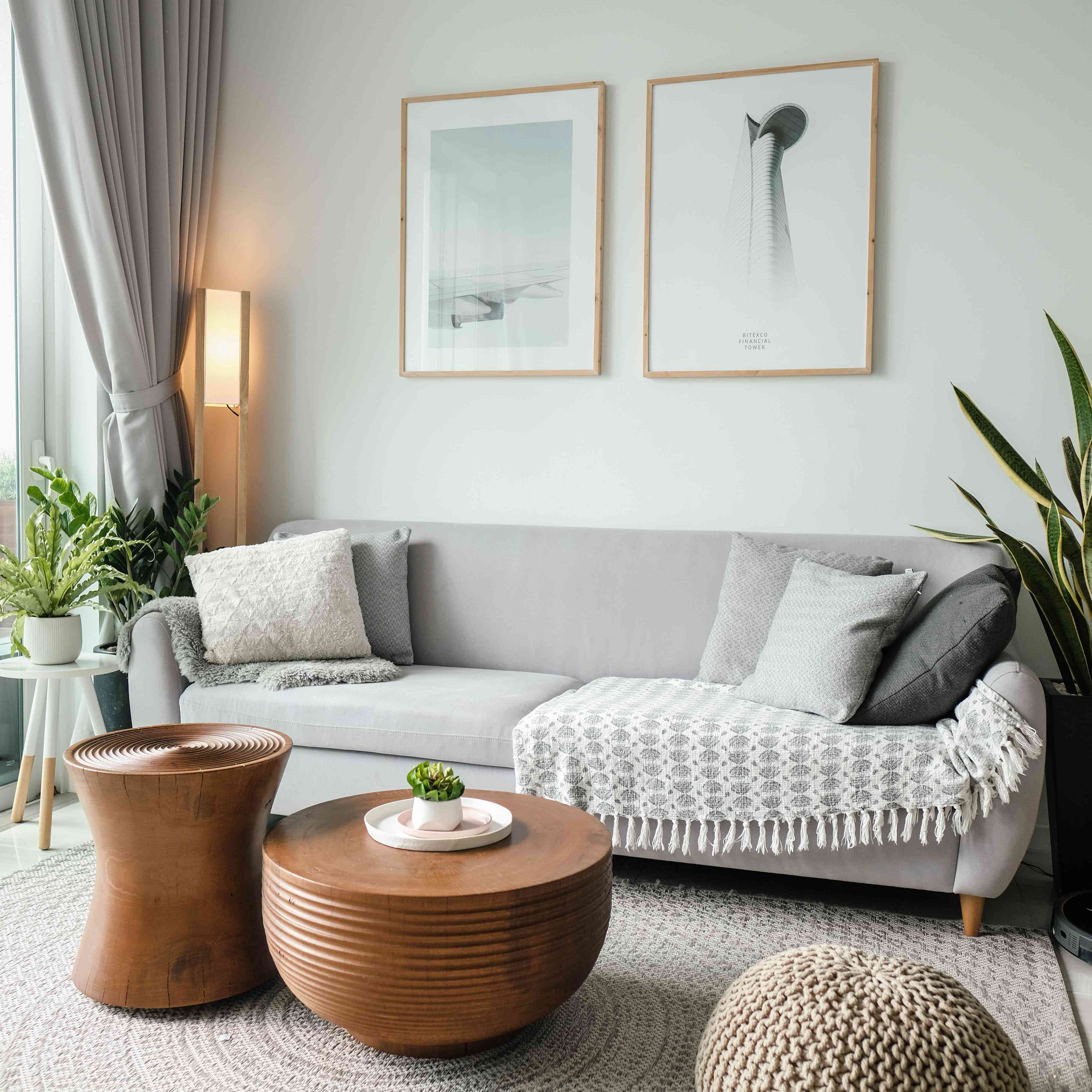 gray living room with rug and wood tables