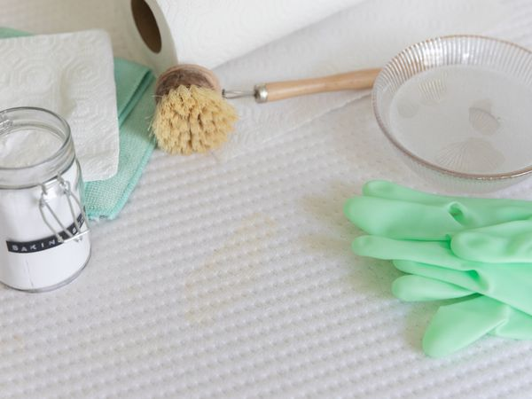 Pee stain on mattress surrounded my materials and tools for cleaning