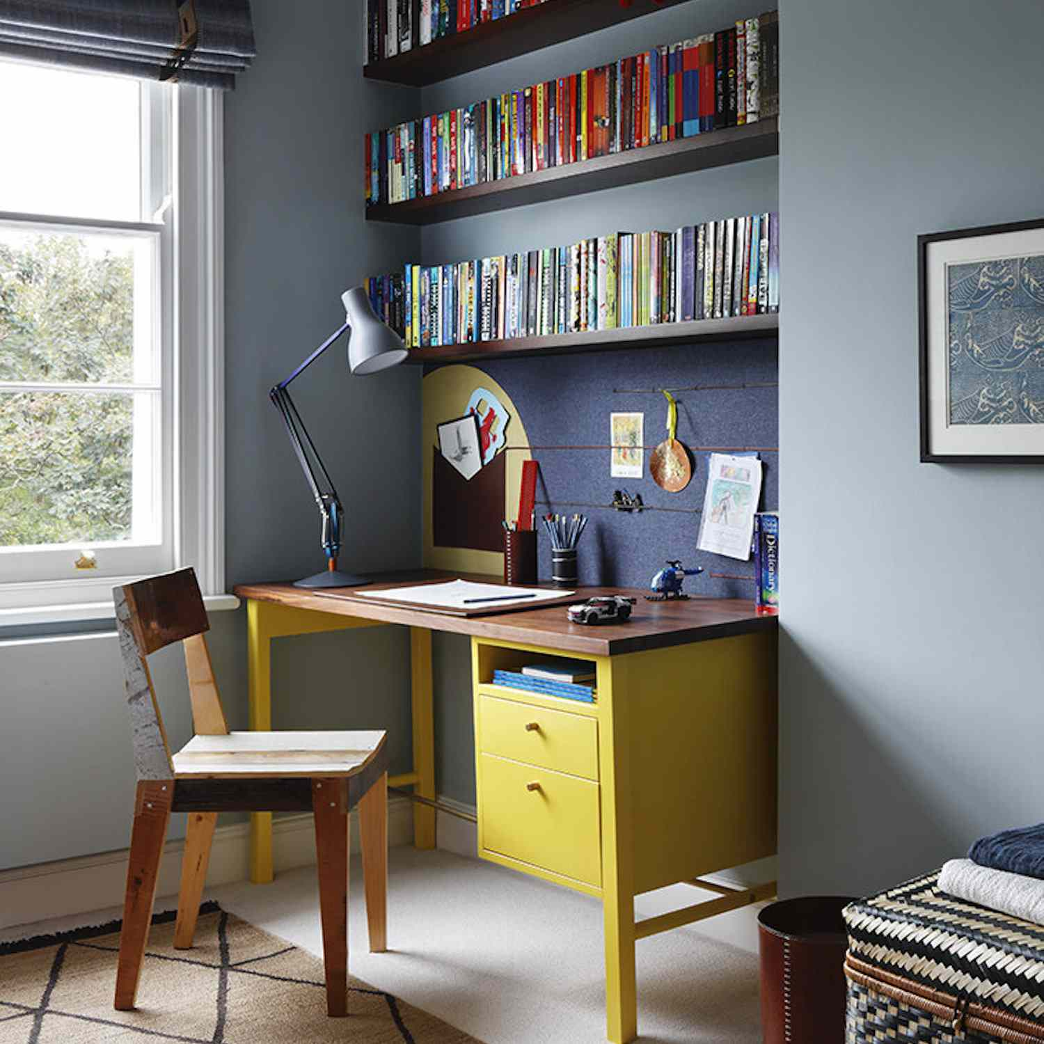 bedroom with study nook, yellow desk with blue walls, bookshelves
