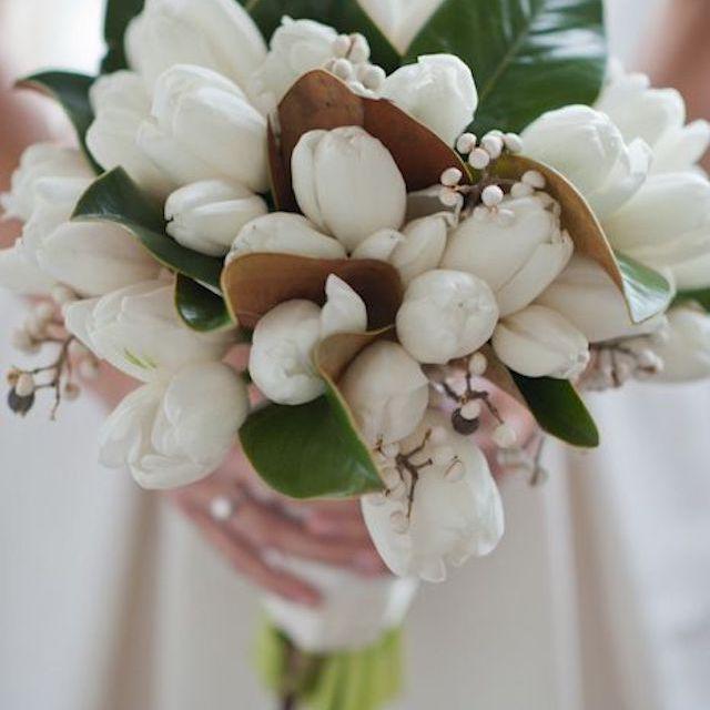 Snowberry, Rose, and Ranunculus Winter Wedding Bouquet