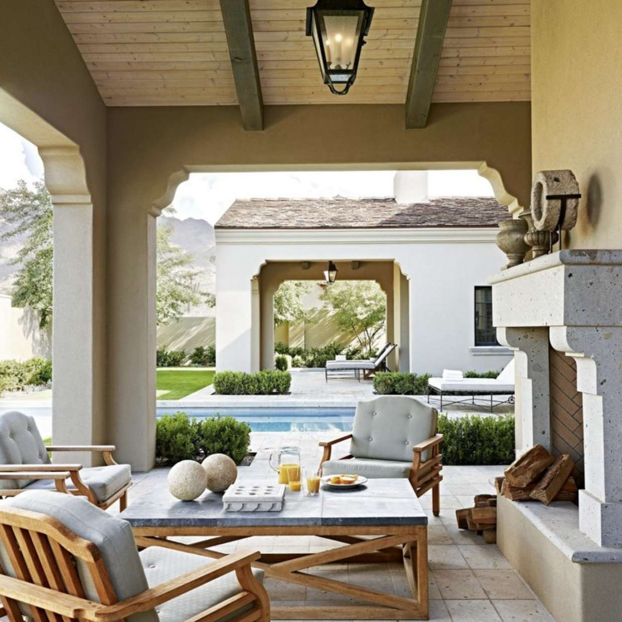 covered patio outdoor living room near pool