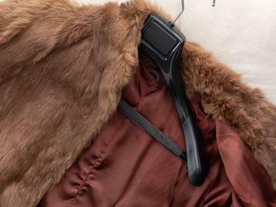 A brown fur coat on a hanger