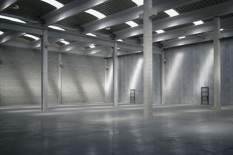 polished concrete floors in an empty warehouse