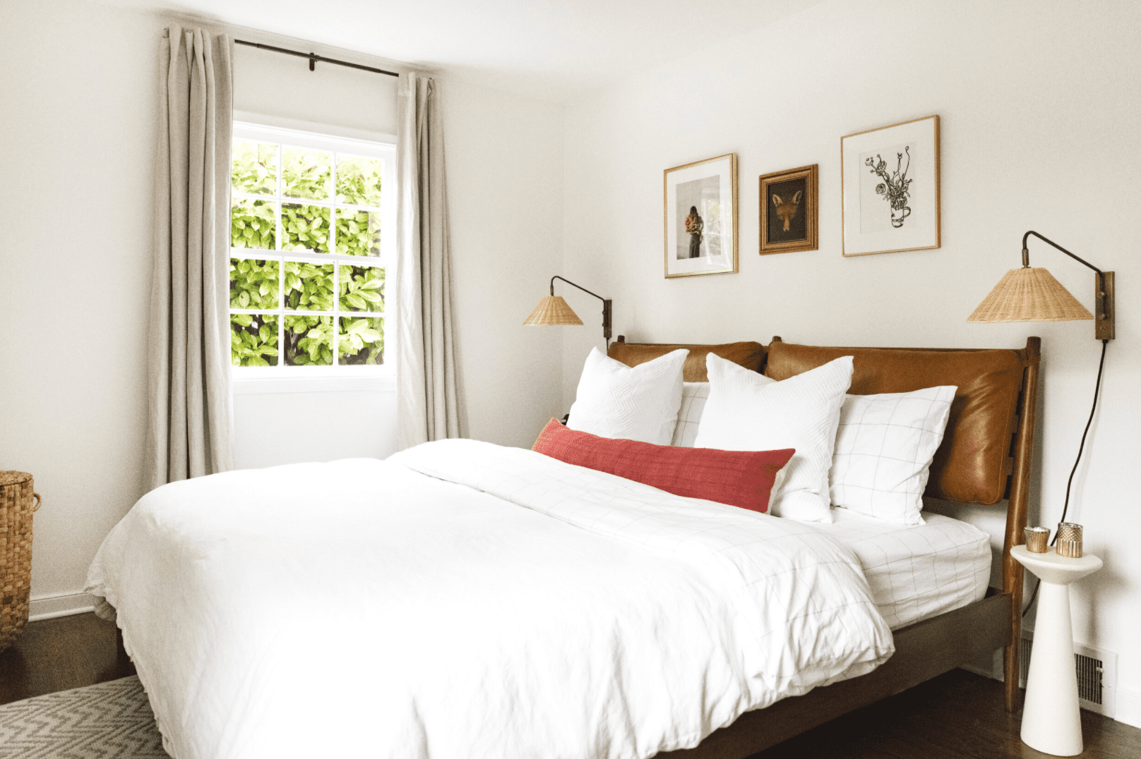 Bedroom with leather headboard and red pillow