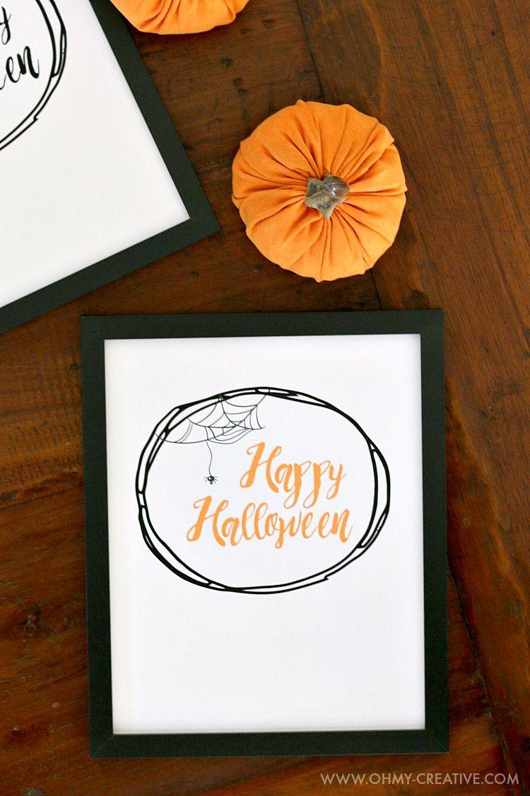 A framed printable on a table with a pumpkin