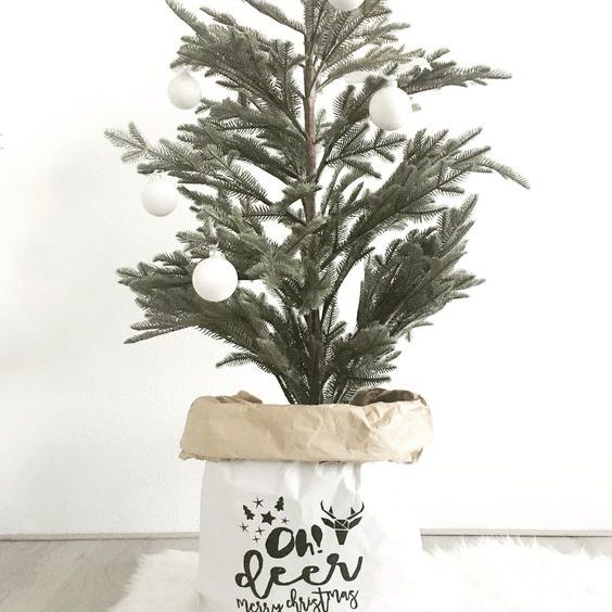 Scandinavian Christmas tree in a bag stand