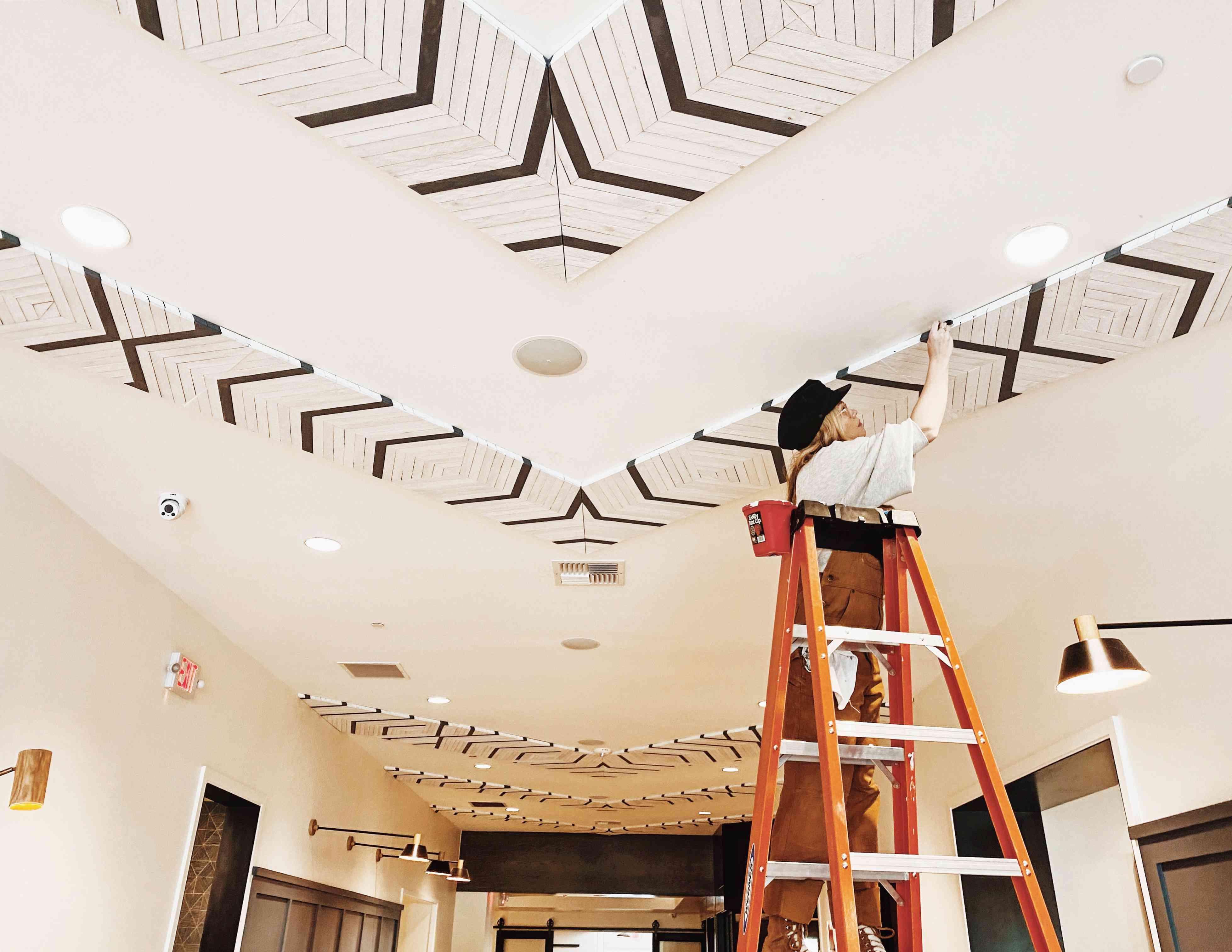 Aleksandra Zee works on a ceiling installation in Sonoma, California