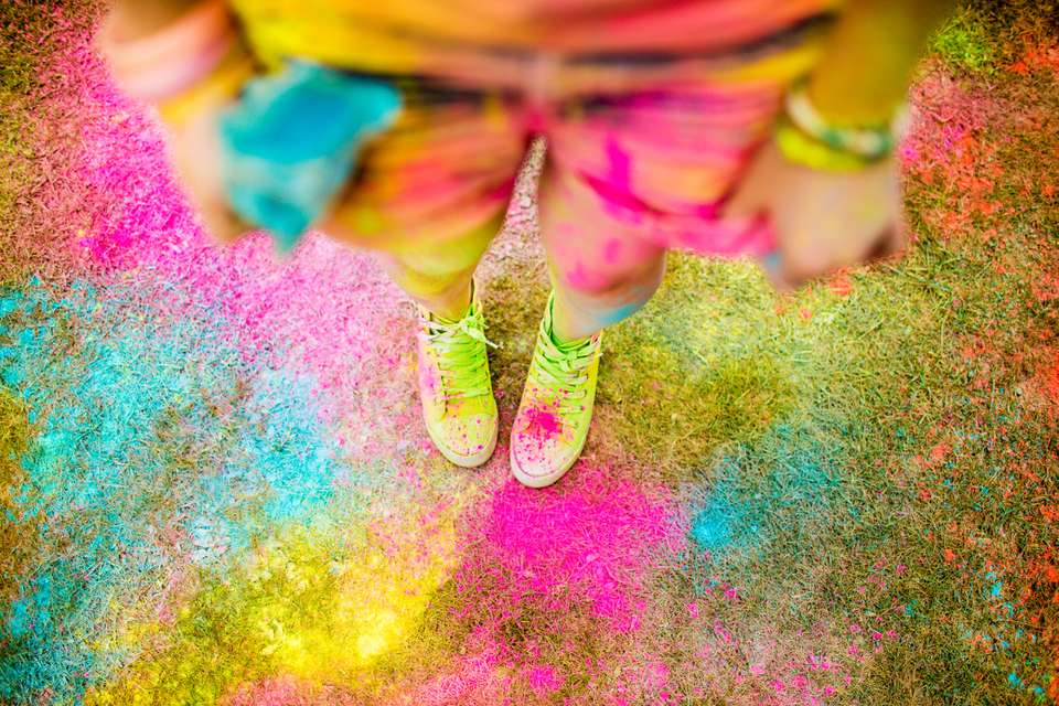 Holi powder festival concept with hipster girl