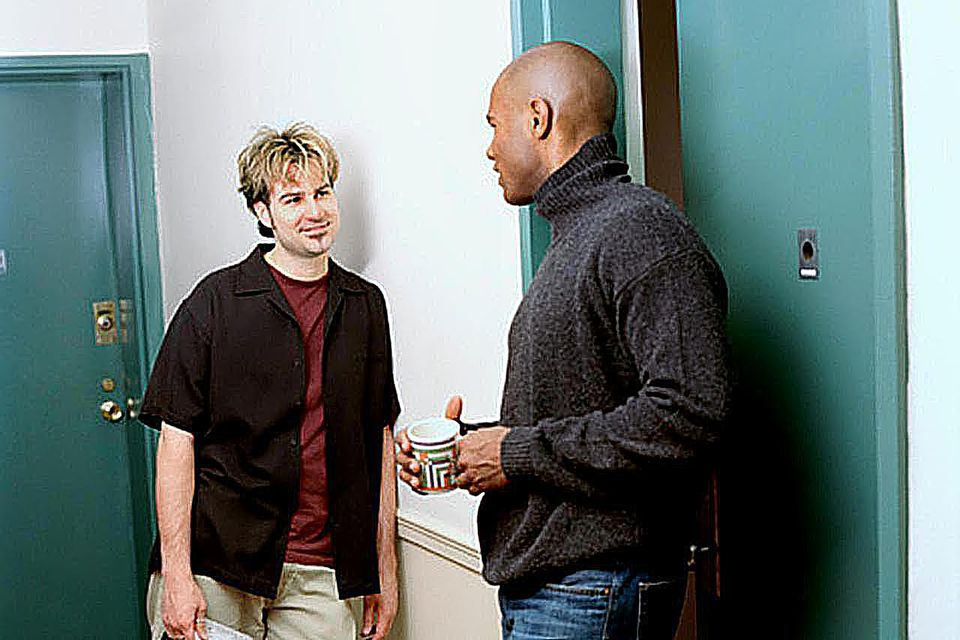 Neighbors chatting in hallway