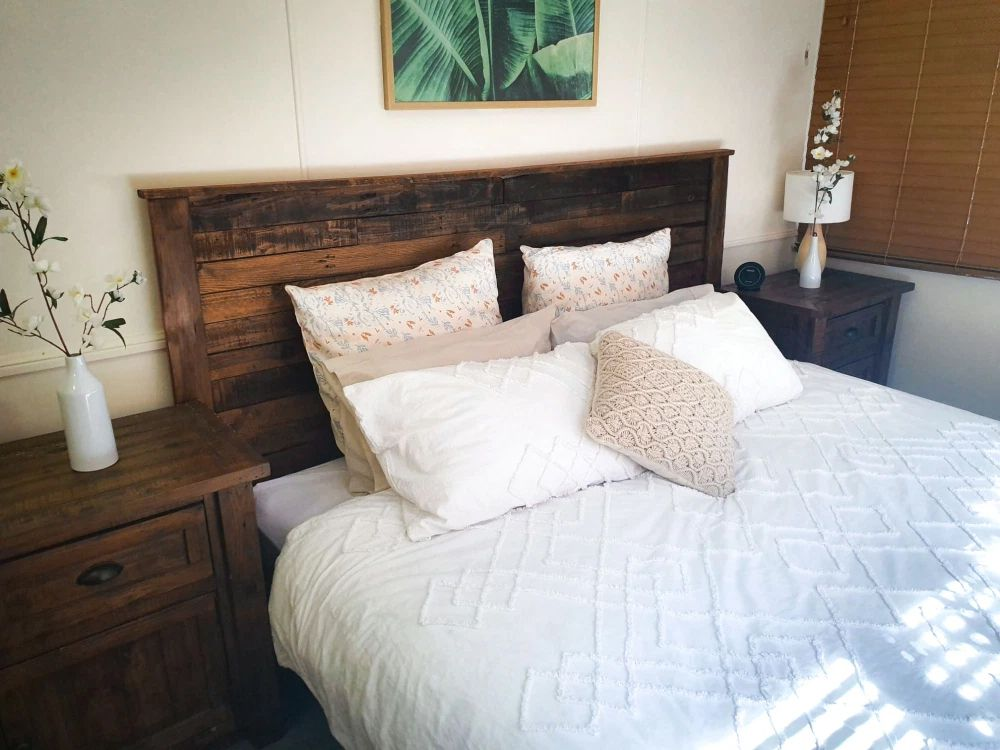 A rustic bed in a bedroom