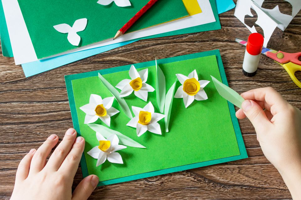 child making paper flowers for a card