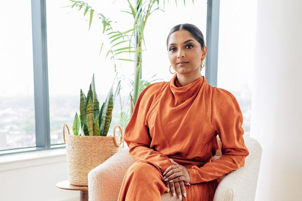 Deepica Mutyala, founder of Live Tinted beauty brand, poses in her apartment