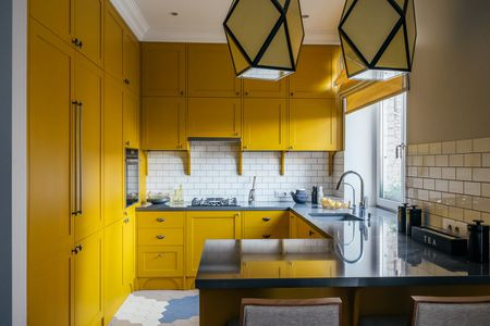 Modern Yellow Kitchen White Backsplash