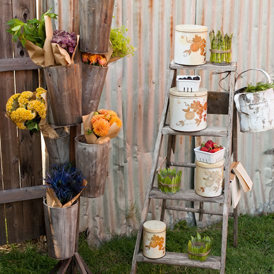 Flowers and fruit by a sign