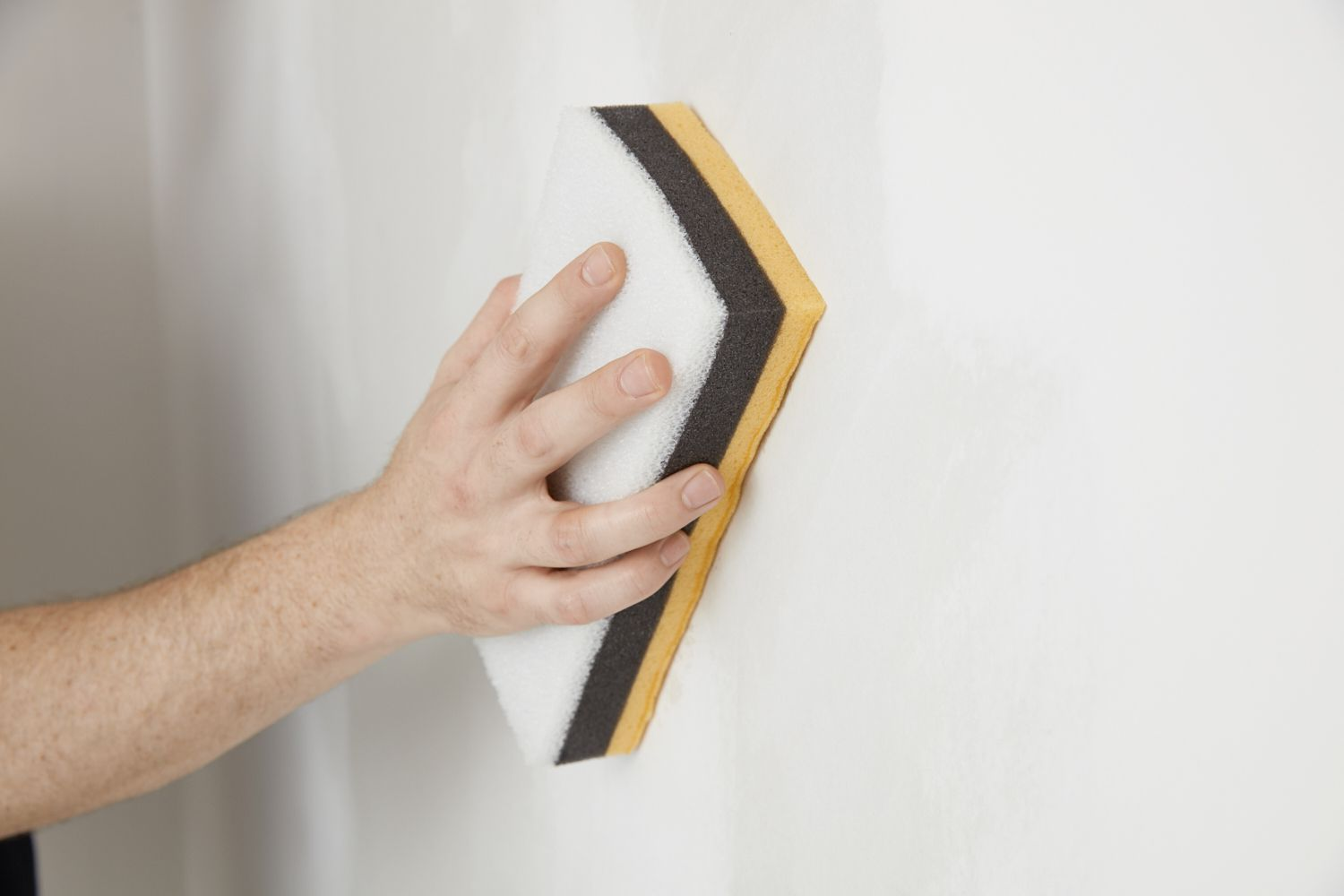 smoothing the drywall