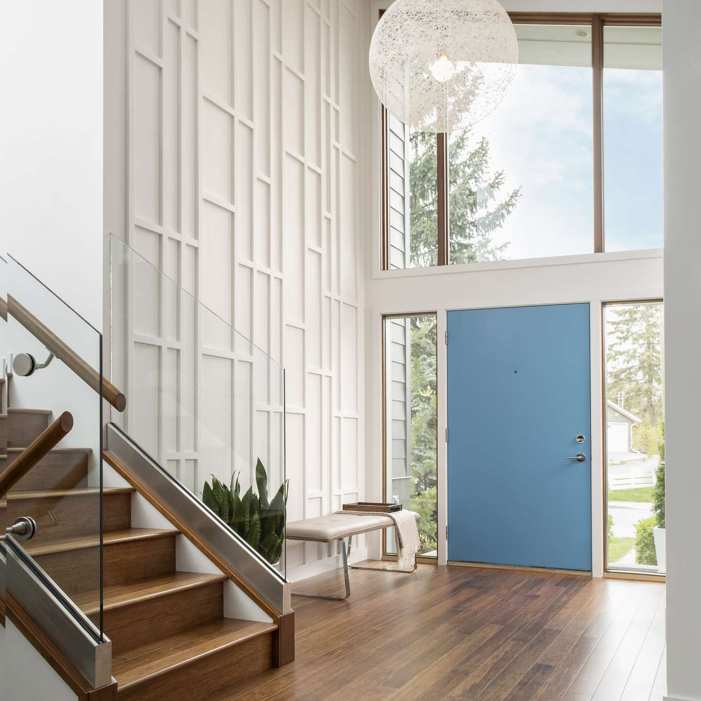 mid century modern entry with blue door
