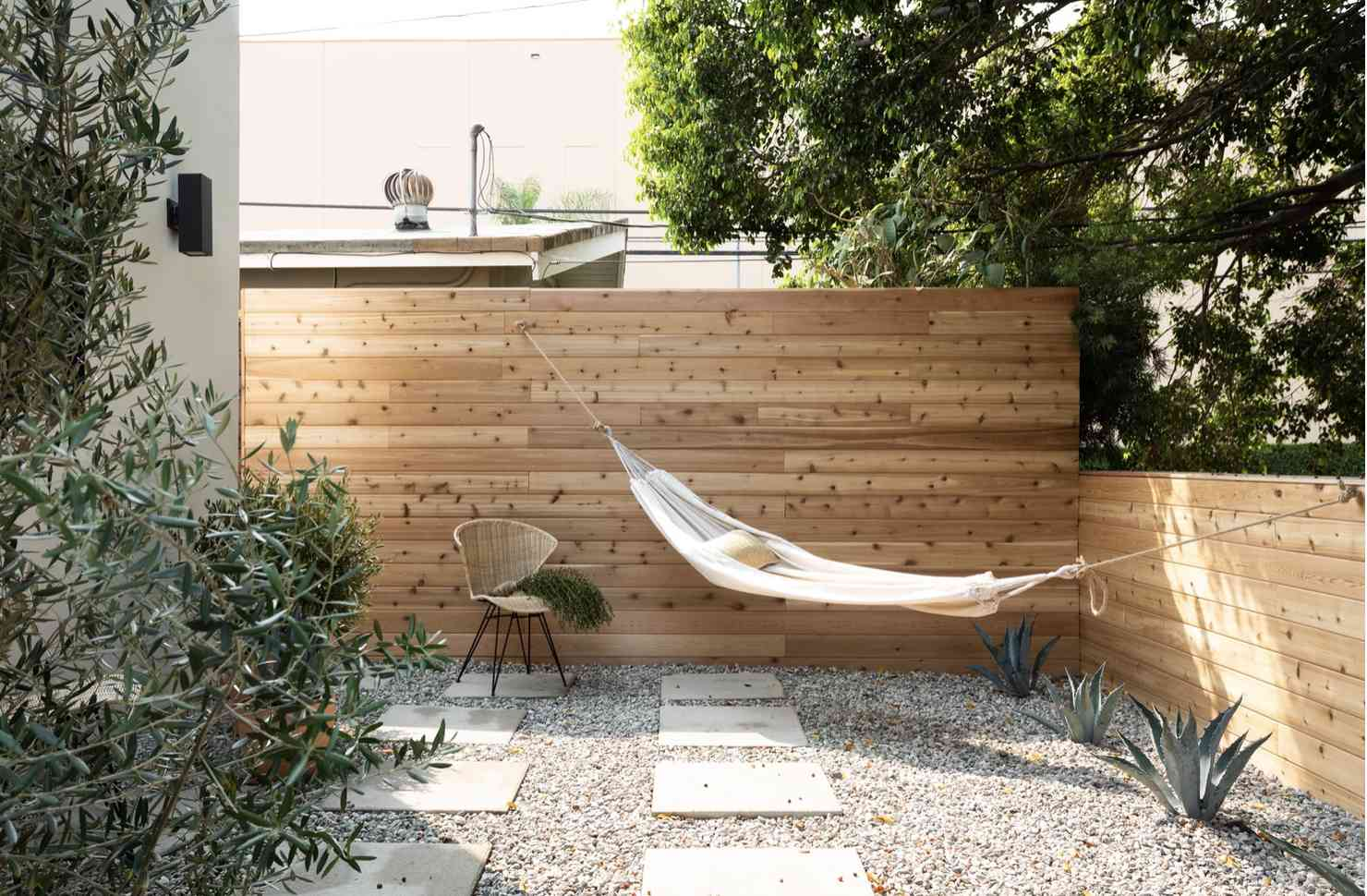 fenced in backyard enclave with hammock