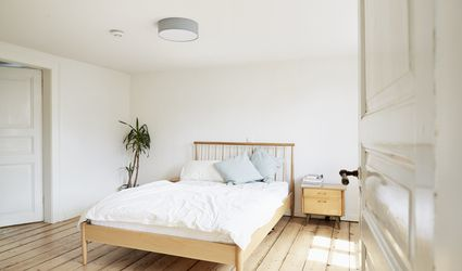 A simple bed in a white room