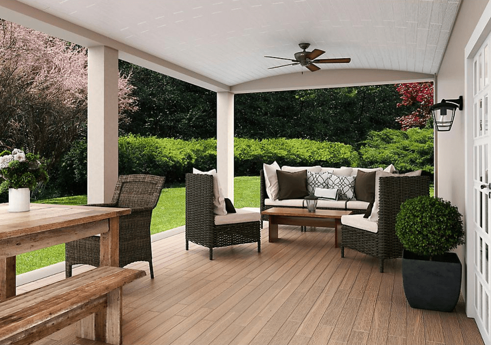 An outdoor seating area with a ceiling fan
