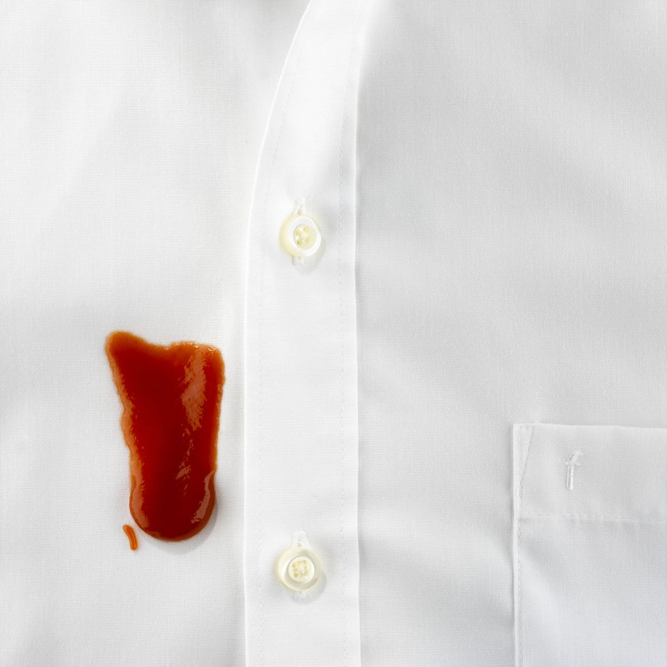 Ketchup stain on a pristine white shirt
