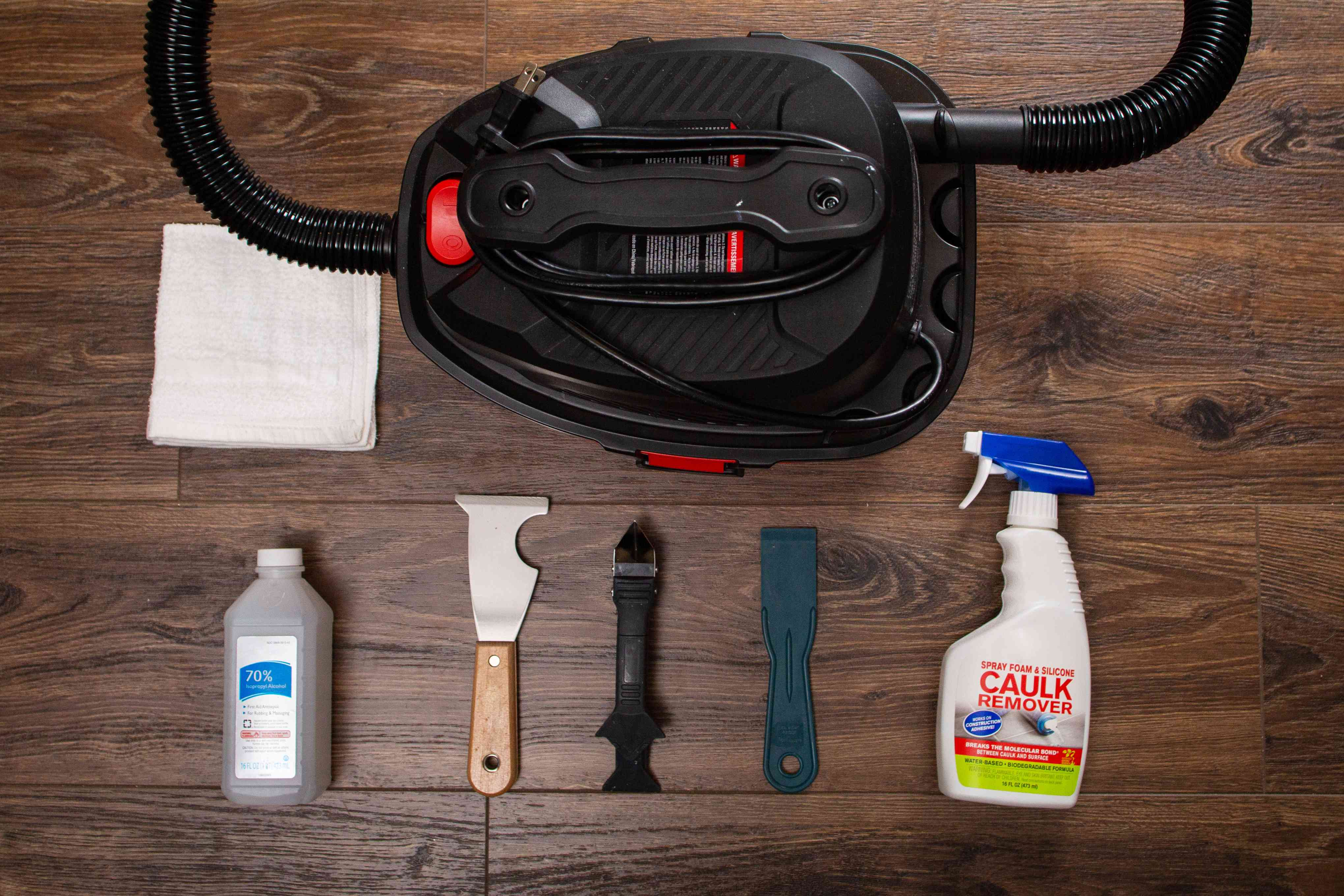 Materials and tools to remove old caulk on wooden surface