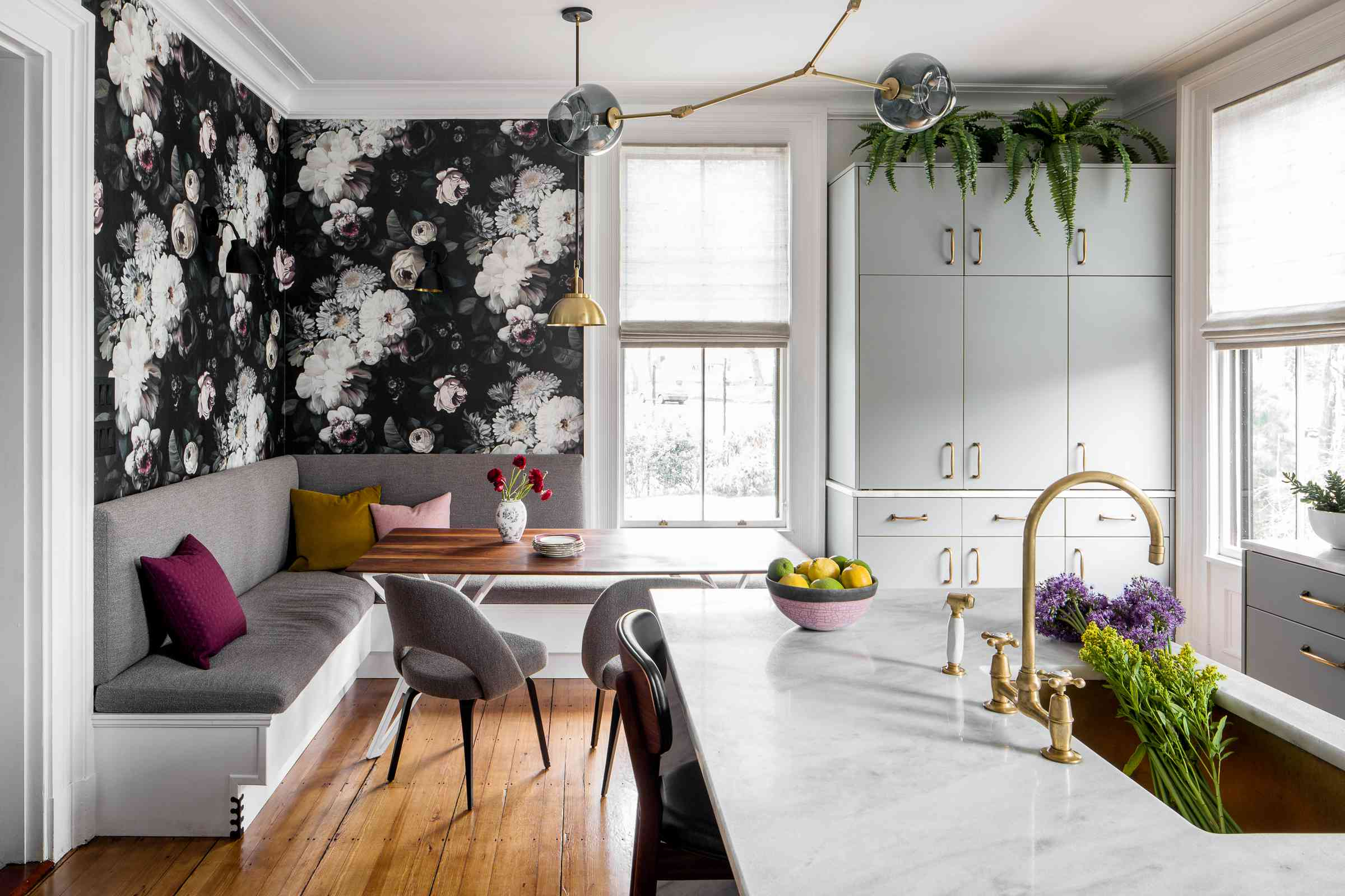 Dark floral wallpaper in a kitchen.